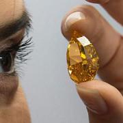 cel mai mare diamant portocaliu din lume vandut la licitatie la geneva