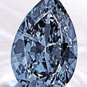 nou record de pret un diamant albastru vandut la licitatie cu aproape 33 de milioane de dolari