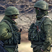 porosenko a prezentat documente de identitate ale unor soldati rusi care lupta in ucraina