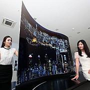 nebunie la salonul de la berlin televizorul cu doua fete si displayul de de 1mm grosime