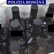 barbat care cumpara sticle goale de whisky pe care le umplea cu alcool apa si arome alimentare si le vindea ca produs original cercetat de politisti