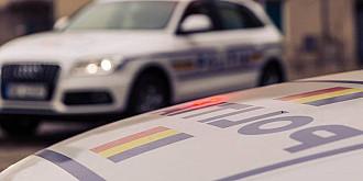 fetita de 7 ani impuscata de un politist aflat in urmarirea unei masini